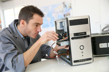 Technician fixing computer hardware