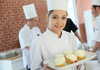 Closeup of smiling young pastry confectioner