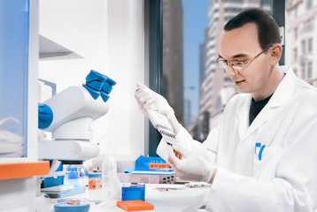 Young male scientist in laboratory