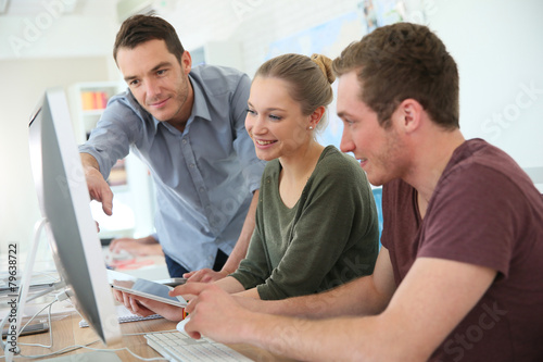 Students in digital design training course with instructor - 79638722