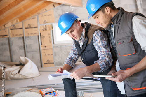 Construction engineers meeting on site - 79638729