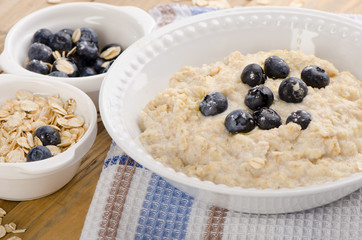Bowl of oatmeal with fresh blueberries. Healthy breakfast