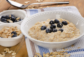 Bowl of oatmeal with fresh blueberries. Healthy traditional brea
