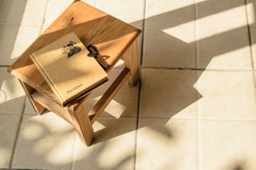 wooden stool in the sunshine