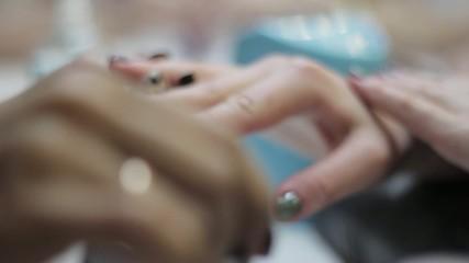 beautician applying nail polish