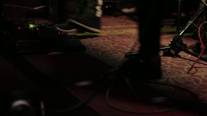 singer's particular shoes during a gig