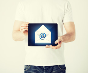 man holding tablet pc with email sign