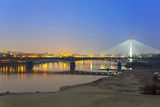 Fototapety Panorama of Warsaw at night with reflection in Vistula river