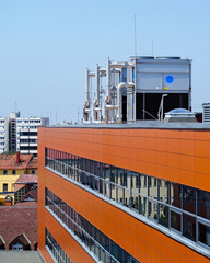 Industrial air conditioners on the roof of an office building