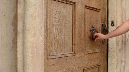 Man Uses Door Knocker