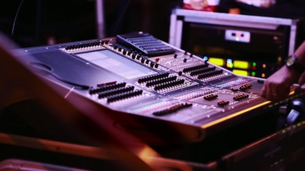 Audio Engineer in front of audio mixing console during show