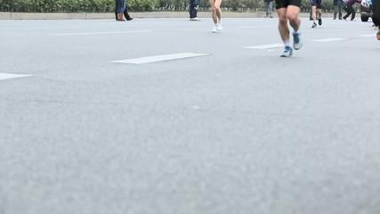 Unidentified marathon runners on the street at Shenzhen Internat