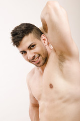 Young fitness latin man showing armpit