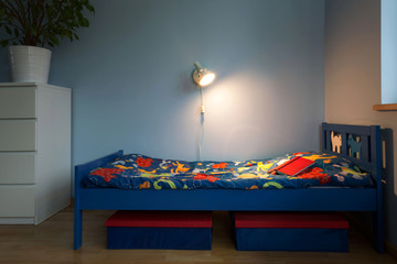 Bed with colorful sheet