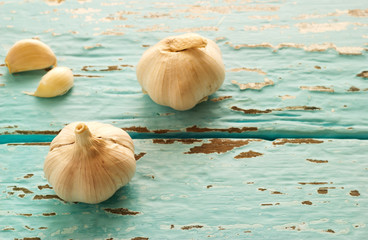 vintage pastel color tone style of garlic on color wooden