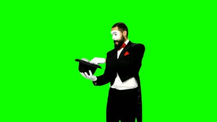 Funny man mime makes magic on green screen