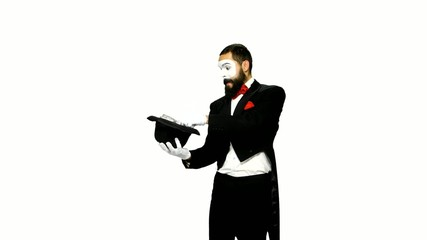 Funny man mime makes magic on white background