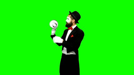Funny man mime uses speaker and tries to fix on green screen