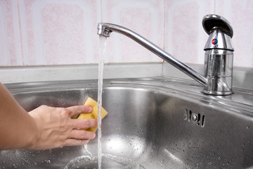 Women's hand washing the sink