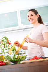 Young woman in the kitchen prepare salad XII