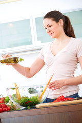 Young woman in the kitchen prepare salad XIII