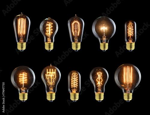 Set of vintage glowing bulb on black - 79647750