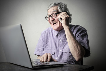 Happy man using a pc