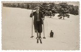Vintage photo from skiing man in snow. Antique picture