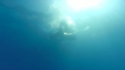 Slow motion underwater dive