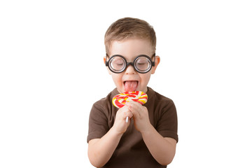 little boy licking lollipop with glasses