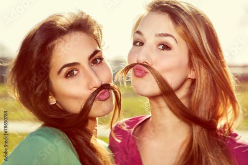 Leinwandbild Motiv Two girls kid around