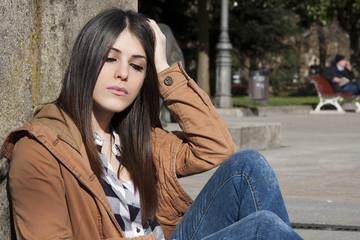 latina brunette girl sitting outdoors
