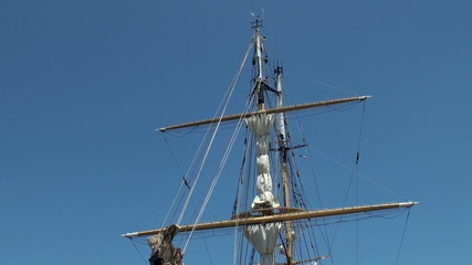 Two-masted sailing ship anchored in Papeete harbor
