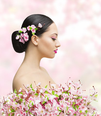 Woman Beauty Portrait in Sakura Flower, Asian Girl Bun Hairstyle