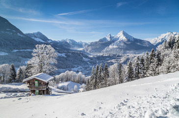 Idyllic winter landscape in the Alps with mountain chalet