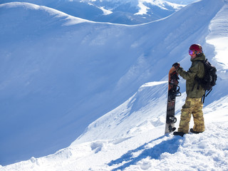 Snowboarder with Splitbord in the mountains.