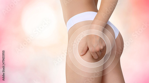 hand controls cellulite on buttocks - 79655950
