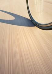 road bike wheel in motion blur on street