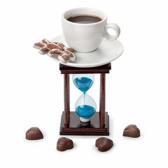 hourglass and a cup of coffee with sweets