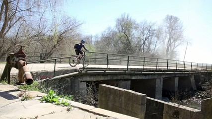 mountain bicycle riding on a country bridge