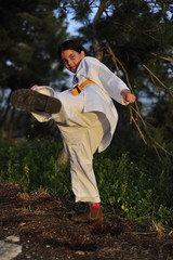 Karate girl is kicking with foot