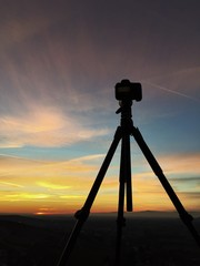 silhouetted camera on tripod