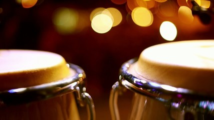 Cool close-up shot of two congas on stage during a performance