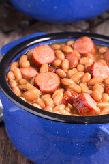 Franks and beans in blue ceramic bowl