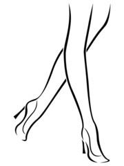 Slender female feet in shoes