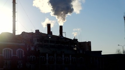 Chimneys of power plant with smog going out
