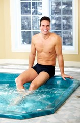 Man relaxing in jacuzzi.