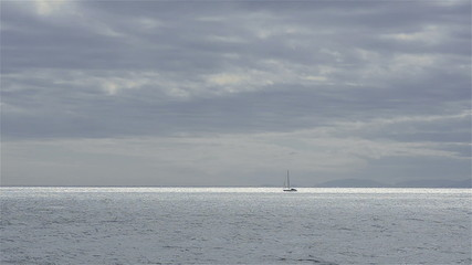 Yacht sails in the bay
