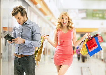 Man surprised of result of shopping