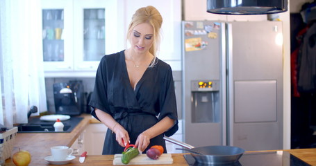 Stylish woman preparing dinner in the kitchen
